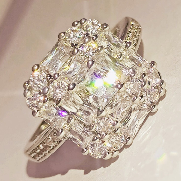 Unique White Sapphire Halo Engagement Ring