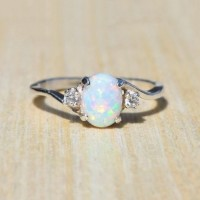 Cute Oval Cut Fire Opal Rings